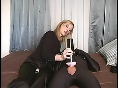 A sexy blonde is playing with penis using sex toy