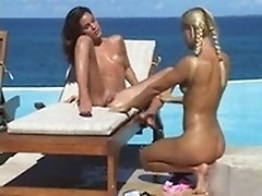 A wonderful bossomy porn model Nella is fisted right by the poolside!