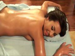 Nasty pornstar gobbles her masseurs cock
