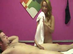 Asian masseuse combines a blowjob and handjob