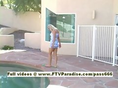 Raylene beautiful blonde babe sits by the pool