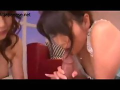 2 Asian Girls Sucking Guy Jerking Off His Cock On The Carpet
