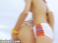 lesbians tease pussies on beach