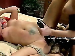 Strong lesbian whore with large tattooes getting spanked in bondage lesbian sex with horny mistress