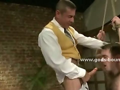 Strong gay master with whip and big tattooes enjoys his time with sex slave bound in ropes