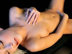 blond angel babe on the leather sofa