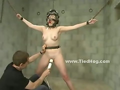 Scared babe with big small tits if this could be possible crucified and tortured by gang of people