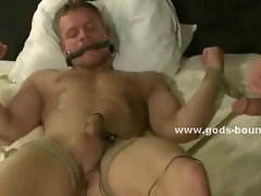 Old basement holds gay slave prisoner bound in ropes and tortured with bondage clips in nasty sex