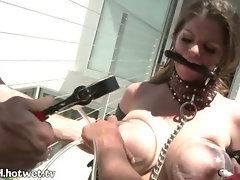 A Sexy Brunette MILF Gets A Milk Sucker