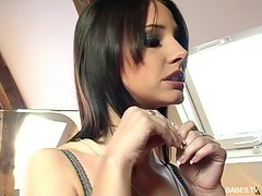 Kiki Klement gets dressed up all sexy and gets ready for her pornshoot