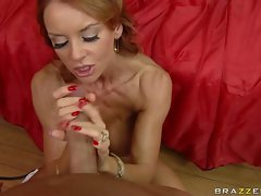 Raunchy redhead Janet Mason teases a giant rod with her mouth and hand