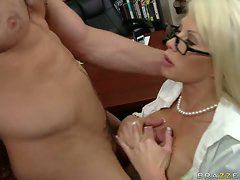 Brooke Haven dons glasses and cock in mouth at the library