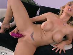 Big boobed Tanya Tate stuffs her wet pussy with some fun toys