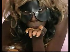Ebony in a mask gets drilled by a white cock and gets a mouthful
