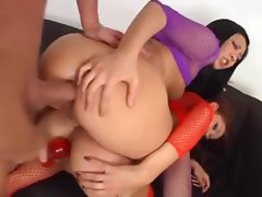Two horny girls play with toys and beads and get nailed in threesome