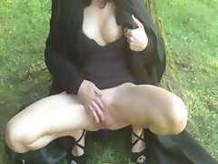 Crazy brunette outside rubbing her pussy for an orgasm in public