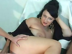 Mature brunette gets a young cock to eat, bang, and get anal