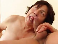 Chubby mature brunette eats young dude's rod and gets nailed