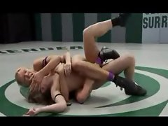 Women wrestle and have femdom strapon sex