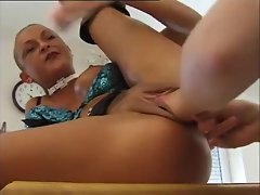 Shaved head girl gets pussy fisted