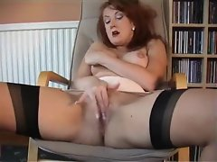 Redheaded milf in retro lingerie plays