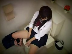 Japanese girl masturbates on the toilet