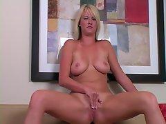 Blonde with shaved pussy masturbates