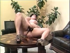 Fat German chick has a big black toy for pussy