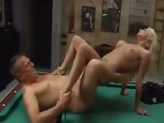 Heavily tattooed blonde fucked on pool table