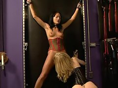 Mature blonde has a slave girl