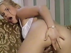 Blonde in white lace bra masturbates sensually
