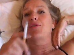 Mature babe enjoys a smoke and a wank