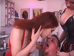 Two redhaired Dominatrix torment slave through cbt and use him as an ashtray