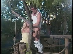 Kinky blonde with nice tits is fucked by muscular farmhand on wooden dock