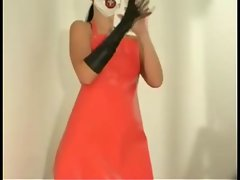 LIZA WEARING RUBBER APRON AND GLOVES