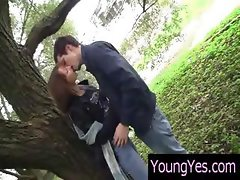 Two teens kiss out under a tree and go home for some loving