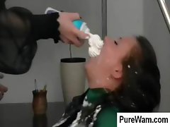 Two crazy lesbians are spreading whip cream all over her body
