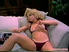 Sexy classic Nina Hartley is horny on her couch wanting some pounding action