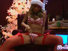 Blonde chick Bree Olson gets too hot to handle in her sexy Christmas outfit