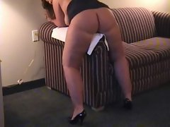 MILF with a plump booty grinds hard onto the arm rest to get her orgasm