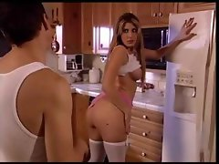 Delicious babe fucking her pussy in kitchen
