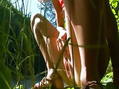Petite croatian chick peeing in a forest