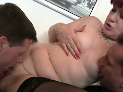 Mature office bitch enjoys two cocks