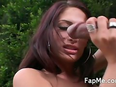 Hot brunette gives handjob outside with cumshot