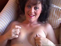 Busty mature brunette smokes and plays with pussy