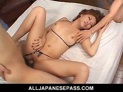 Japanese milf fucks in a tiny bikini