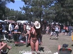 Coeds at a nudist colony festival