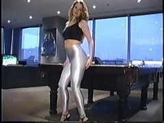 girl in shiny silver spandex and heels