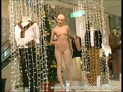 Naked alive mannequins sit in store