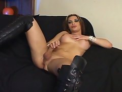 Busty latin tranny loves being fucked on the black sofa